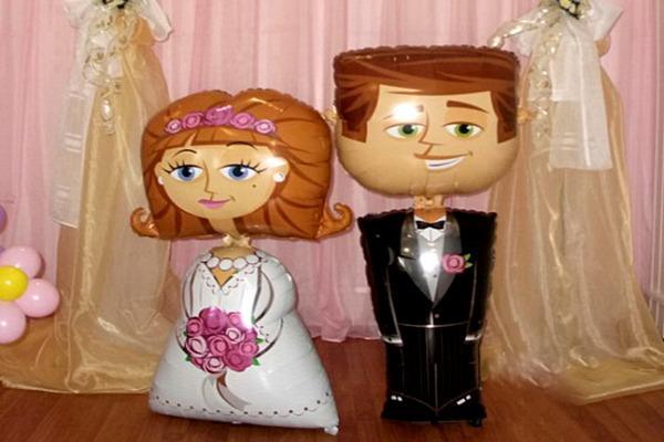 Фигурки жениха и невесты из фольгированных воздушных шаров